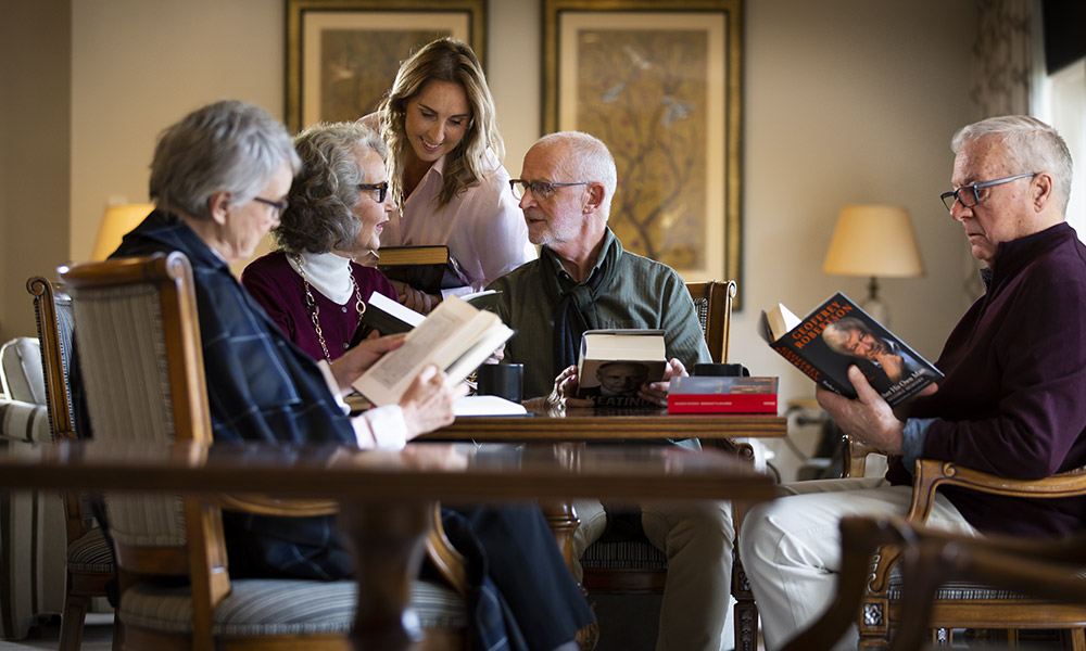 Prospect Hill Camberwell, retirement living - group reading around a table